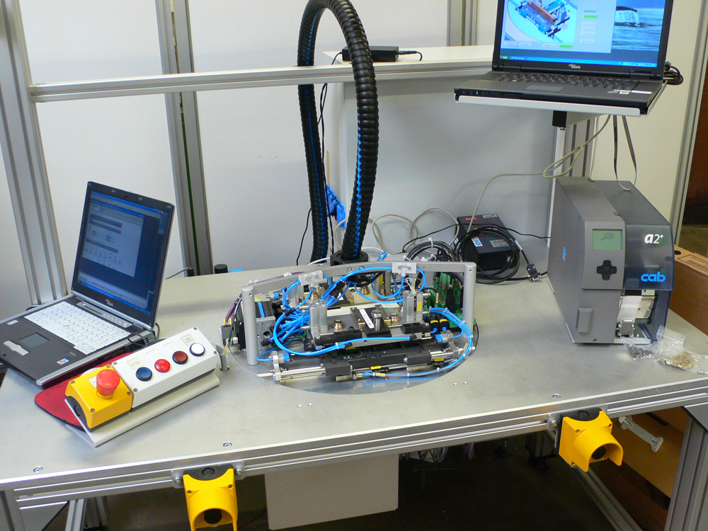 Assembly and testing machine